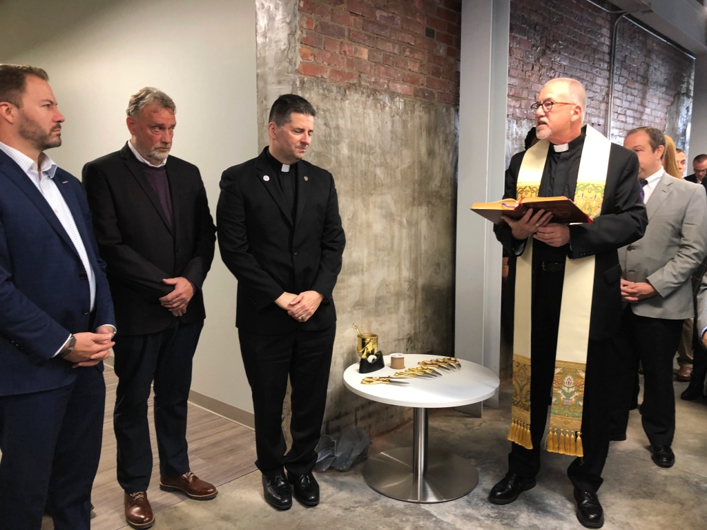 Father Aidan Rooney blesses TReC 616 Niagara business incubator. Niagara Falls.